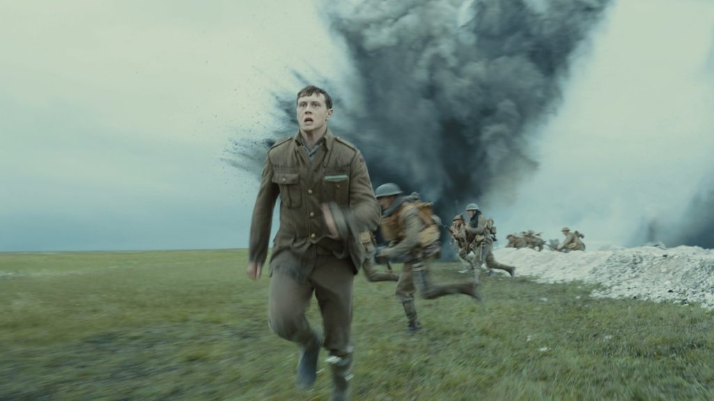 George MacKay in the movie 1917, running across a field